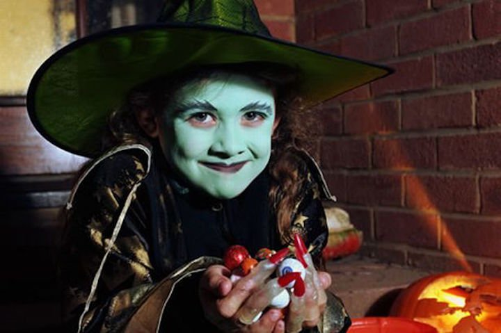 child-dressed-in-fancy-dress-as-a-witch-for-halloween-image-1-227929670