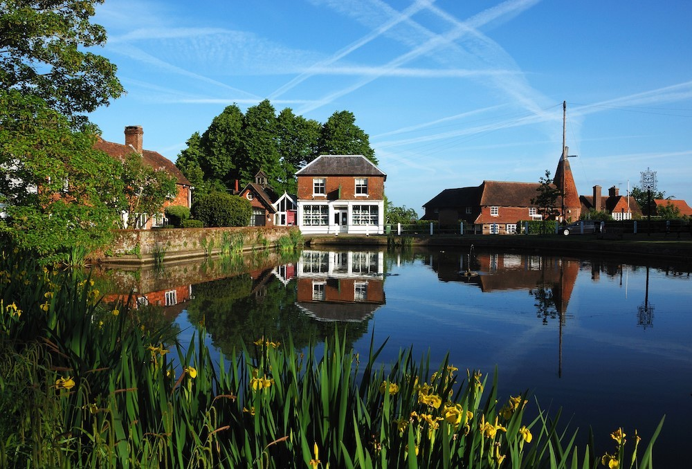 The village of Goudhurst, overlooking the pond with houses in the background.
